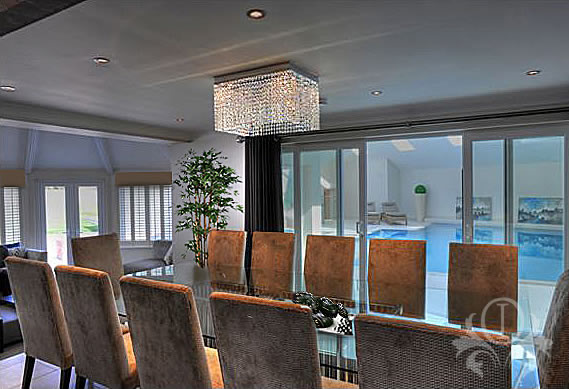 Lighting design dining room overlooking swimming pool for Interior design lighting uk