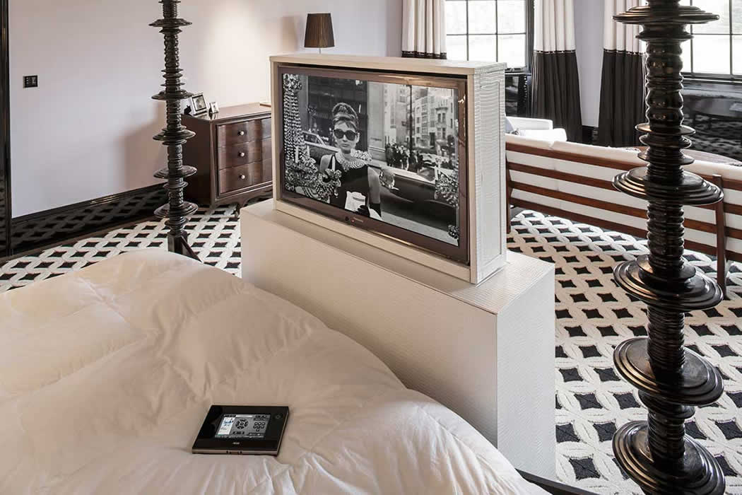 Audio visual installation in bedroom of luxury house for Interior design surrey